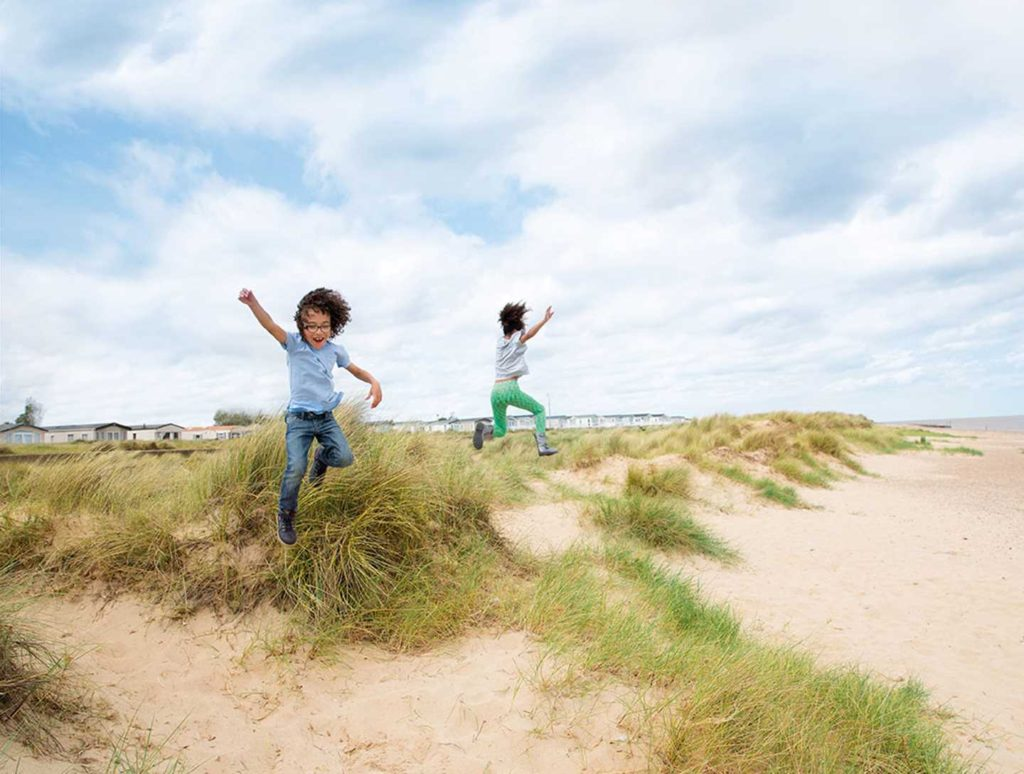kids jumping on the beach